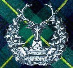 Tartans of the Scottish Regiments WWI. Gordon Highlanders (Kilted) Gordon tartan backed badge
