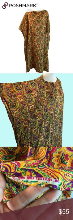 """Vtg Jim Brady Bright Paisley Kaftan Tent Dress Jim Brady Designs, Venice CA Bright Paisley Kaftan Tent Dress with Boat Neckline One Size John Wolf Textiles Inc.  ?------measurements------- (all taken with the garment laying flat)  Chest 39"""" Length back of Neck to Hem 52"""" Waist 40"""" (loose) Hips 40"""" (loose) Sweep 44"""" across at hem Side Slits 6"""" Fabric Content feels like Cotton Blend (no tags) 5"""" fabric in Hem NO Interior tags, but if handy you might take some of the hem fabric for an interior…"""