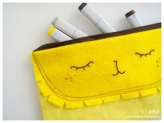 *FACES COLLECTION*    Cute makeup bag or pencil case.    Motif: Leo  Color: yellow  Materials: cotton, felt  Closure: Zipper *The color varies from ca