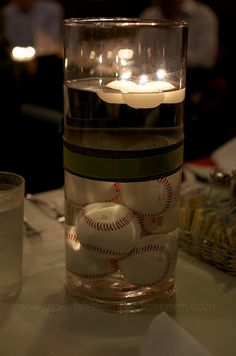 Rehearsal dinner .. Floating Candle Centerpiece  I think baseball themes are adorable! Maybe I should marry a baseball player...