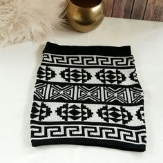 "AZTEC | Knitted Skirt Woven black & white, Aztec sweater skirt!  This fitted style skirt has a 1.5"" in. elastic lined waist (No zippers or buttons to mess with!)   *NEW!* Size: XS/S (24"" - 26"" in. waist) Skirt Length: 14.5 "" in. (flat) HERA Skirts Mini"