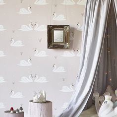 Elegant swans wearing gold crowns is fit for a princess and will look serene and beautiful in any little girl's bedroom.This wallpaper design is non woven ie 'paste the wall'. Roll length: 10 metres (11 yards)Roll width: 52cm (20.5ins)Pattern repeat: 64cm (25 ins) half drop