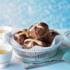 Spiced chocolate and orange hot cross buns recipe. Hot cross buns are traditionally eaten on Good Friday, hot from the oven with lashings of butter. Try this chocolate and orange hot cross bun recipe for a bit of variation this Easter.