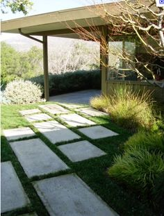 Staggered rectangular concrete stepping stones. Gorgeous for backyard!