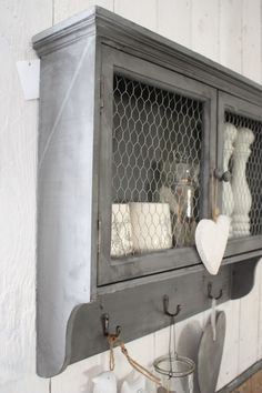 LOVE chicken wire in rustic accent colour storage pieces bookcases and short buffets great too