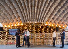 Arched pavilion created out of upcycled beverage cartons.