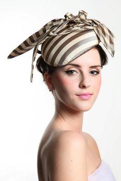 Preston. Regency striped silk in golden ecru, with curls and knots in opposing stripes.