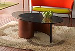 Spiral Coffee Table by Richard Judd. This classic form - a perennial bestseller with our customers - creates an atmosphere of pure glamour. Dark African wenge edges punctuate a glossy, dappled spiral of pommele sapele veneer over luan plywood. 0.5