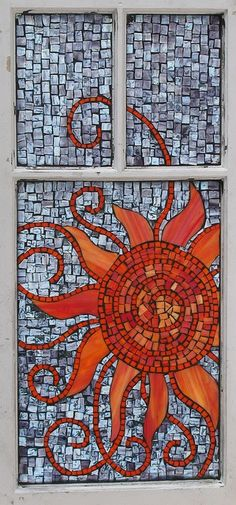 Mosaic sun this looks like that unglazed tile and vitreous glass and stained glass pieces in an old window frame.....how cool!