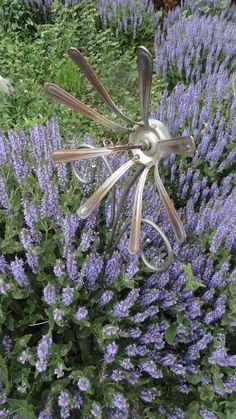 In my garden.... recycled spoon handle flower. $42.00.  Visit us on Facebook at Flying Pig Metal Art!