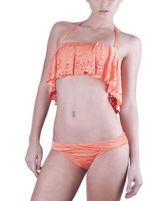 Bring a bit of romance to that beachside getaway with this sweet bikini set. A one-of-a-kind top features flowing fabric, scalloped edges and intriguing cutouts, crafting a look that's guaranteed to turn heads. Includes top and bottoms91% nylon / 9% spandexHand wash; dry flatMade in th...