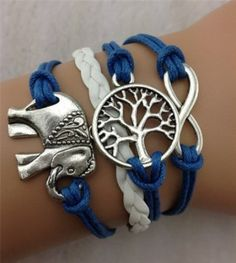 I want this soo bad!!!!! Tree of life and an elephant!!!! Screams Jessica