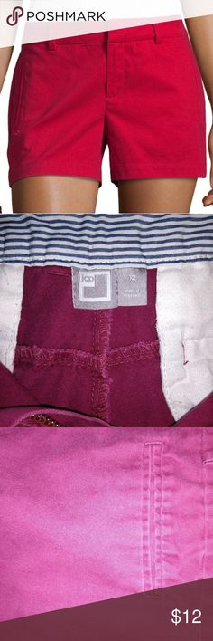 Twill Flat Front Shorts JCP Modeling Red Shorts actual shorts are Wine color Fit: Modern Short Length: Short Length Rise: At Waist Fabric Description: Twill Fabric Content: 98% Cotton, 2% Spandex Closure Type: Button W/Hook&eye Pockets: 2 Front Slip Pockets Front Style: Flat Front Inseam: 3 1/2 In Care: Machine Wash Country of Origin: Imported Color: Wine a.n.a Shorts