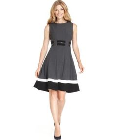 Calvin Klein Sleeveless Belted Striped Dress. Add comfortable black heels, minimal modern jewelry and a clutch or sleek shoulder bag and you have a modern professional look that will work in almost any professional environment.