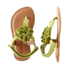 Add some flower power to your feet in these bright green leather sandals. Pretty and comfort come together in a dressy casual sandal perfect for al...