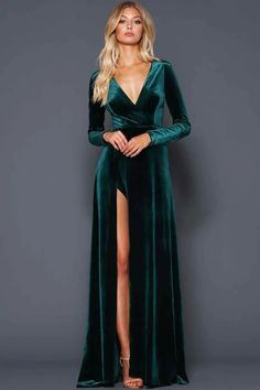 A beautiful full length dress by Elle Zeitoune. A velvet gown featuring a deep v-neckline and high side split. Emerald Green Bridesmaid Dresses, Velvet Bridesmaid Dresses, Green Wedding Dresses, Emerald Green Dresses, Emerald Green Velvet Dress, Emerald Green Wedding Dress, Emerald Gown, Velvet Dress Prom, Green Gown Dress