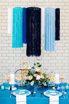 DIY yarn chandelier - photo by Emily Chidester Photography http://ruffledblog.com/best-of-2014-diy #diyproject #weddingdiy
