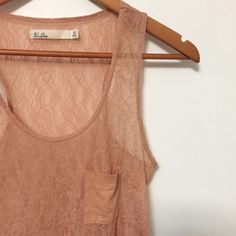 Madewell Hi-Line Lace Tank With Pocket Beautiful quality and condition on this lace tank. I just haven't found a way to work it into my wardrobe. Features a cute little pocket on the chest and racerback styling. Excellent Condition.  If you have any questions or would like additional pics/measurements I'd be delighted to help  No PP, trades only through Poshmark (mutual price drop), please make offers with the offer button. Happy Poshing! Madewell Tops Tank Tops
