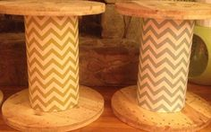Reclaimed large wooden spools as side/end tables with chevron print fabric