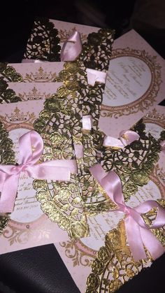 """Submitted by Brandon! GORGEOUS pink and gold wrapped invitations using our low cost 10"""" gold foil paper doilies!"""