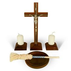 "Polish Christmas Epiphany Blessing Kit. Celebrate the Polish Catholic Epiphany Tradition with this wooden Polish Blessing Kit. The set SHOWN ABOVE includes: 1 crucifix, 2 candles w/ candle holders, 1 holy water basin and 1 sprinkler (kropidło).  Metal & Wood Crucifix: 4.0""L x 8.75""H  Candles: 1.2"" Dia x 2.0""H, Wooden Candle holders: 2.25""L x 2.25"" W x 1.5"" H,  Wooden Holy Water Basin: 3.9"" Dia x 0.8""H  Sprinkler: 7.75""L Product - Made in Poland   All items are included & shipped in one box."