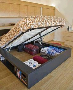Creative storage solution for RV Glamper beds that lift - redo under bed box with external storage compartments to allow easy access for books, shoes, etc... when bed is closed, while still retaining bulk storage under the bed. Add sliding doors to contain items while traveling down the road.
