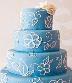 Wedding Cakes: Sky blue with white flower details