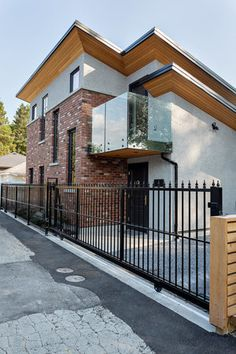 Exterior of the award-winning Luxury Laneway renovation by Madeleine Design Group in Vancouver