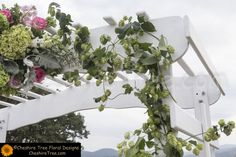 !lecours-05-boscobel-wedding-flowers-ceremony-arch-hops-hydrangea-pink-gree-white A closeup of the wedding arch decorated with hops vines