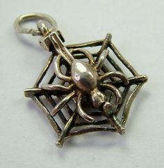 A 1960s English silver Nuvo charm of a spider in a web that opens to reveal a blue enamel painted fly inside - 38gbp