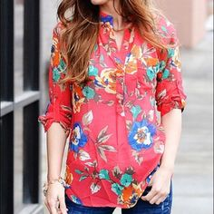 Floral sheer blouse. Only worn once. This sheer blouse has a pretty floral print. Main color is a rich coral color with accents of blue, green, yellow and more. Buttons partway down the front. Sleeves have a button strap to make them shorter. Boutique Tops Blouses