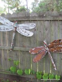 Repurposed table legs and fan blades for outdoor dragonflies!