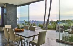 This dining room features glass doors that offer city to ocean views and access to the private backyard. 1750 Viewmont Drive | Hollywood Hills