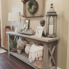 Marvelous Farmhouse Style Home Decor Idea (45), Grey stained table, Boxwood wreath hung in crate with burlap