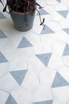 Triangle tiles. This would be great in my new bathroom perhaps