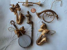 6 vintage gold musical instrument ornaments - angel on accordion - 60s GLAM. $ 7.50, via Etsy.