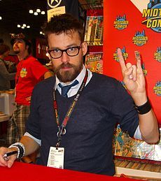"Matt Fraction gives you the full monty as a Marvel writer! Born Matt Fritchman (he Americanized it), he started out as a fan when DC published ""Crisis,"" but found that storyline confusing and became a Marvel buff. As a pro, he writes for that company, especially ""Hawkeye,"" setting the Avenging archer in Brooklyn. His wife is Kelly Sue DeConnick, also a comics writer (Marvel's ""Captain Marvel,"" alias Carol Danvers)."