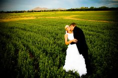 All you need is love....and an open field of lush greens for an awesome photo with your new husband. #ArizonaWeddings Who's an #Arizona #bride?