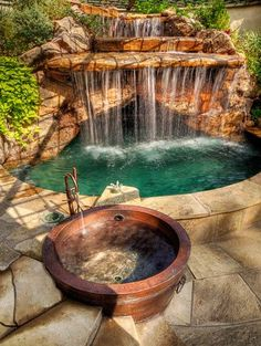 Backyard oasis with copper hot tub and waterfall pool.