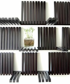Piano shelf by Sebastian Erraruriz Available in black or white. Completely adjustable to whatever size object you want to store or display. Folds flat against the wall when not in use. Smart.