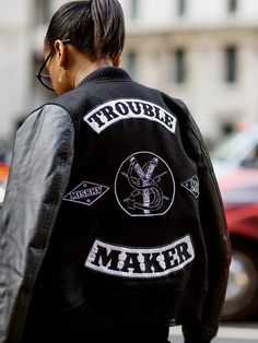 A varsity jacket with patches makes a cool statement // Photo: The Styleograph #LFW #streetstyle