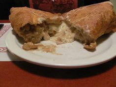 Canadian Calzone  Poutine (fries, cheese & brown gravy) cooked inside a calzone and deep fried.