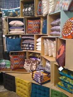 pillow display  store display. Visual merchandising. Boxes stacked to house pillows. Could use this idea instead of a craft fair table.
