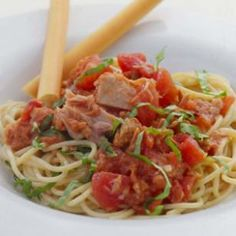 Inspired by the Italian dish spaghetti al tonno e pomodoro, this quick and healthy pasta became a staff favorite at EatingWell.