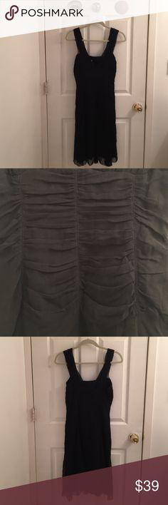 NWT ELIE TAHARI Black Dress NWT ELIE TAHARI Elegant Black Dress. Size: 6. Side zip entry. Fully lined. Bra friendly. Pretty pleated like chiffon on dress. This dress can take u anywhere! 100% silk. Dry clean only. Elie Tahari Dresses Midi