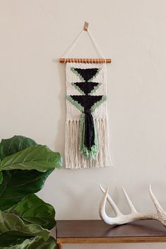 Geometric Black and Mint Woven Wall Hanging by aHalcyonInHand