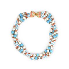 Kenneth Jay Lane is known for his stunning costume jewellery whom counted Diana Vreeland and Audrey Hepburn as a fans. This roped necklace is designed with faux turqouise, white and coral beads with rhinestone details. The clasp is a statement detail designed with a gold toned metal and multicoloured enamel design with diamante detail.