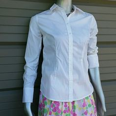 Like New Merona White Button Blouse Brand Merona  Size Small  97 % Cotton 3 % Spandex  Like new Classic women's fit button up /down shirt, pure bright white with cute cuff button design, collared. Perfect for the ofgice. Bundles available with discounts Merona Tops Button Down Shirts