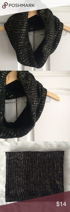 Gold and black cowl scarf Beautiful gold and black cowl neck scarf. Soft furry-fleece like lining on the inside! Could be reversible! Excellent condition! Could be casual or dressy! Accessories Scarves & Wraps