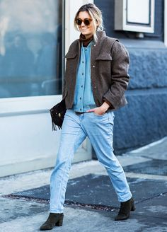 Winter Layering Ideas From the Streets of New York via @WhoWhatWearUK// Team 2 bomber jackets together with a turtleneck and straight-leg jeans.